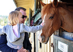 Father and daughter at the Equestrian Center.