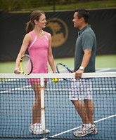 Couple playing tennis at The Tennis Center
