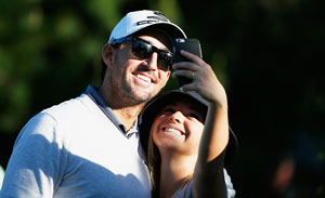 Jake Owens poses with fan at AT&T Pebble Beach Pro-Am