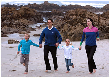 Family on running on the beach.